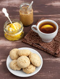 Cookies and tea. With lemon and peanut butter royalty free stock images