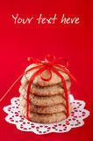 Cookies tied with red ribbon Stock Photos