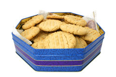 Cookies In A Tin. Christmas cookies in a decorative tin isolated over white Stock Images