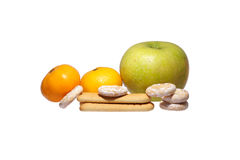 Cookies, two mandarin and apple. Royalty Free Stock Photography