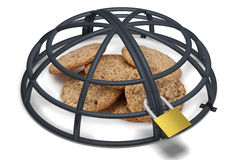 Cookies under a metallic locked cage Stock Images