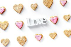 Cookies for Valentine Day heartshaped white background top view. Cookies for Valentine`s Day heartshaped on white background top view pattern Royalty Free Stock Photo
