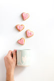 Cookies for Valentine Day heartshaped white background top view pattern. Cookies for Valentine`s Day heartshaped on white background top view pattern Royalty Free Stock Image