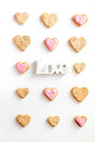 Cookies for Valentine Day heartshaped white background top view pattern Royalty Free Stock Images