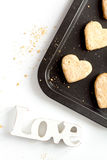 Cookies for Valentine Day heartshaped on white background top view. Cookies for Valentine`s Day heartshaped on white background top view Royalty Free Stock Photos