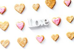 Cookies for Valentine Day heartshaped white background top view. Cookies for Valentine`s Day heartshaped on white background top view pattern Stock Photo