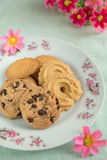 Cookies variety on plate with flowers Stock Image