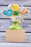Cookies in vase, blank card. Three bright Easter biscuits Royalty Free Stock Photography