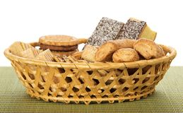 Cookies in a wattled basket on the bamboo cloth Stock Photos