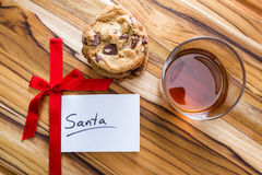 Cookies and whiskey for santa. View form a above at a stack of cookies and a glass with whiskey and a white note for santa Stock Photography