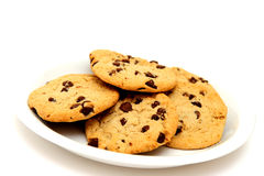 Cookies On White Plate. Chocolate Chip Cookies on a glossy white saucer with a white background Stock Photo