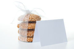 Cookies with white ribbon and a card Royalty Free Stock Photos