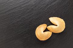 Cookies with the wishes. Traditional Chinese pastry with the wishes or predictions on a black background Stock Images