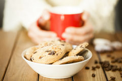 Cookies and woman holding a cup Royalty Free Stock Photo