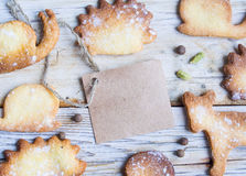 Cookies on a wood table. Piece of paper for love letter and cookies on a wood table stock photo