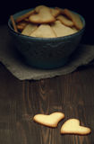 Cookies on wooden background. Heart shaped cookies for valentine`s day Royalty Free Stock Photo