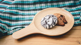 Cookies on a wooden pan and blue cloth. Cookies on a wooden pan stock photography