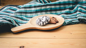 Cookies on a wooden pan and blue cloth. Cookies on a wooden pan stock image