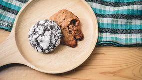 Cookies on a wooden pan and blue cloth. Cookies on a wooden pan stock photos