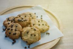 Cookies in wooden tray. Closeup cookies in wooden tray in warm light Royalty Free Stock Photography