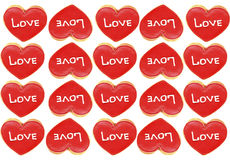 Cookies. The word LOVE. Cookies. Red hearts on a white background Stock Photos
