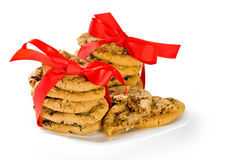 Cookies wrapped in red ribbon Royalty Free Stock Photos