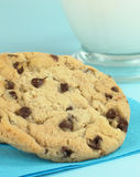 Cookies For You!. Chocolate chip cookies, still warm and gooey from the oven, with a glass of cold milk. Shallow depth-of-field royalty free stock images