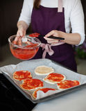 Cookin of pizza. Pizza cooking for birthday party indoor Stock Photos