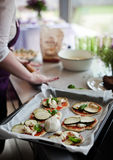 Cookin of pizza. Pizza cooking for birthday party indoor Royalty Free Stock Photography