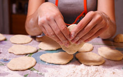 Cooking. Woman makes a tasty pies Stock Photos