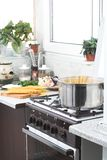 Cooking. Kitchen, cooking traditional pasta in metal pop Stock Photography