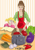 Cooking. Mother and daughter Cooking dish of fresh vegetables Royalty Free Stock Images