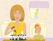 Cooking. The mother and daughter on kitchen cooks food Stock Photo