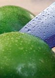 Cooking. Green apples and a knife Royalty Free Stock Images