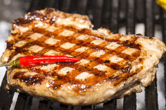 Cooking A Steak On The Grill Royalty Free Stock Photography