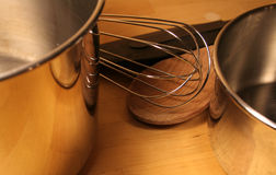 Cooking Aids. Various cooking tools sitting on a wooden table Royalty Free Stock Photo