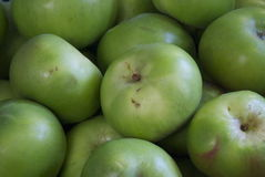 Cooking apples. Pile of ripe green cooking apples on an open air fruit and vegetable market stall Stock Image