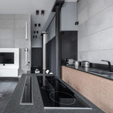 Cooking area in multifunctional apartment. Open cooking area in modern and multifunctional apartment royalty free stock images
