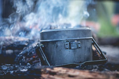 Cooking army pot. On bonfire Royalty Free Stock Photos