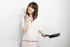 Cooking asian young woman. This photo is cooking asian young woman Stock Images
