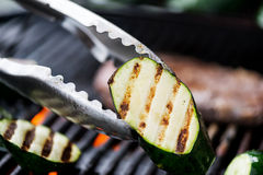 Cooking aubergine or eggplant on grill Stock Photos