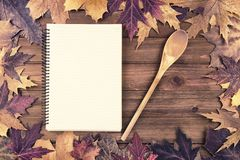 Cooking background with autumn fall leaves on wooden table. royalty free stock photo