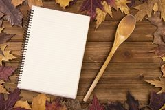 Cooking background with autumn fall leaves on wooden table. View from above Stock Images