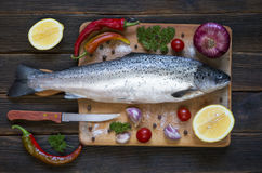 Cooking background, fish on the blackboard, top view royalty free stock photo