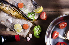 Cooking background. Smoked fish with spices,fruits and lemon on Royalty Free Stock Photo