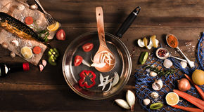 Cooking background. Smoked fish with spices and lemon on a woode Royalty Free Stock Photography