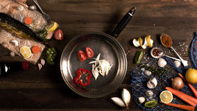 Cooking background. Smoked fish with spices and lemon on a woode Royalty Free Stock Image