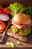Cooking bacon cheese burger with beef patty tomato onion Royalty Free Stock Image