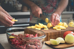 Cooking baked meat with potatoes  and vegetable horizontal Stock Images