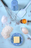 Cooking and baking concept with eggs, flour, sugar and butter - vertical. Stock Photos